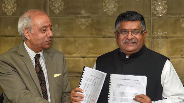 Union law minister Ravi Shankar Prasad accepts a report on Data Protection Framework from Justice BN Srikrishna, in New Delhi on Friday.(PTI photo)