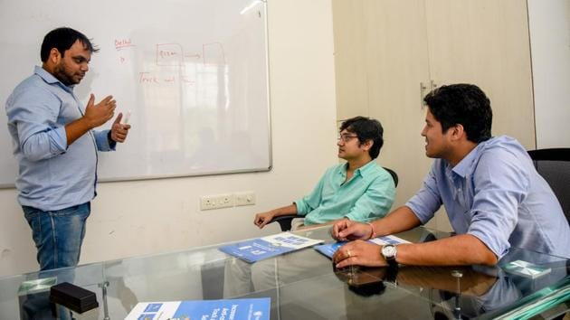 (From L-R) Yogesh Miharia, Nitin Gupta, Abhishek Agrawal at their office in Baner on Friday.(Sanket Wankhade/HT PHOTO)
