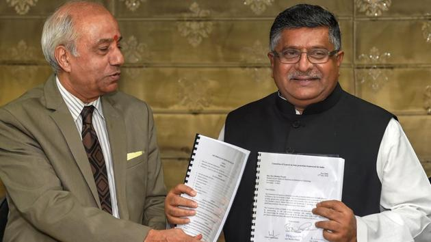 Union law minister Ravi Shankar Prasad accepts a report on 'Data Protection Framework' from justice BN Srikrishna in New Delhi on July 27.(PTI Photo)