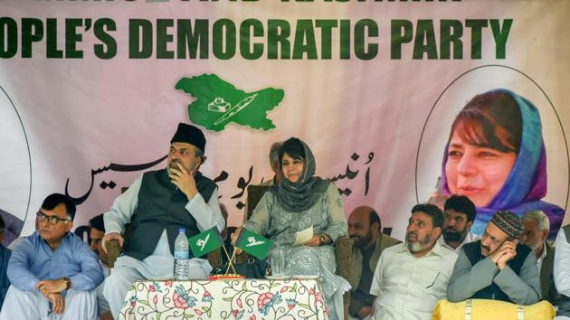 People's Democratic Party (PDP) President Mehbooba Mufti with her legislators and senior party leaders at her first public rally after stepping down as Jammu and Kashmir chief minister, at Sher-e-Kashmir Park, in Srinagar.(PTI Photo)