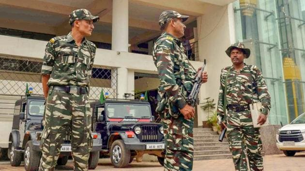 Security personnel guard in front of the NRC office at Bhangagarh in Guwahati on Sunday, July 29, 2018. The final draft of Assam's National Register of Citizens (NRC) will be published on 30th July, 2018.(PTI)
