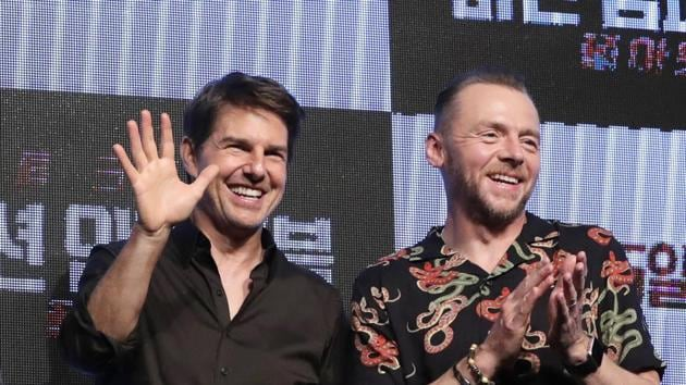 Henry Cavill, director Christopher McQuarrie, actor Tom Cruise and actor Simon Pegg wave to the media after a news conference for their new movie Mission: Impossible - Fallout in Seoul, South Korea.(AP)