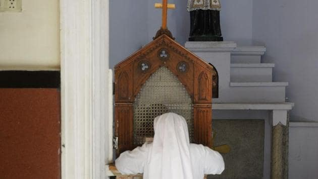 A nun in confession at Saint Mary's Basilica in Secunderabad. The National Commission for Women has recommended the abolition of the practice of confession in Catholic Churches in the country, claiming they are used for exploiting people.(AFP)