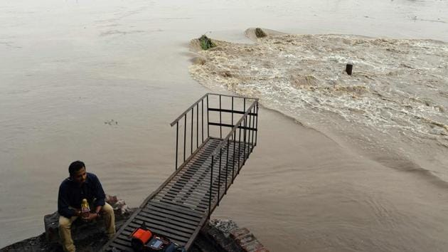 The Yamuna river flows above the danger mark in New Delhi.(AFP Photo)
