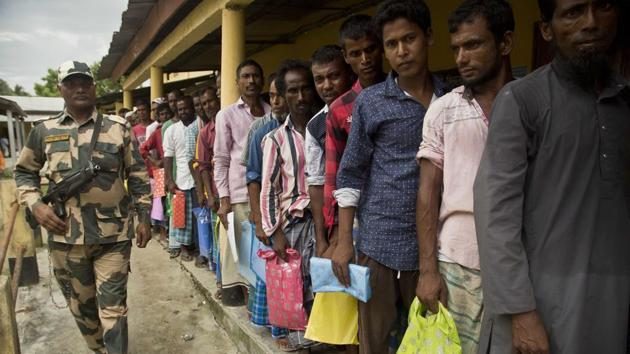 People stand in a queue to check if their names are included in the National Register of Citizens at a draft centre in Bur Gaon village, India, Monday, July 30, 2018. India on Monday released a final draft of a list of its citizens in Assam.(AP Photo)