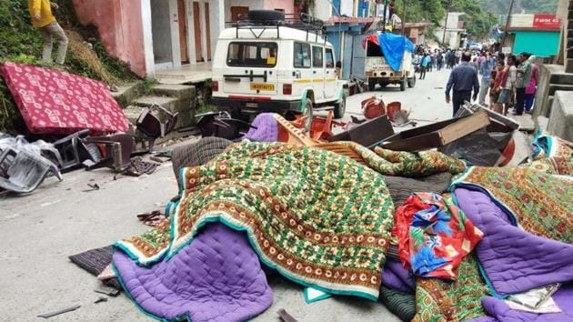 Furniture and other items lying outside a shop after a clash in Ghansali, Uttarakhand on Monday, July 30, 2018.(HT Photo)