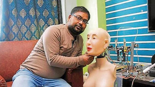 "Ranjit Srivastava with his Hindi speaking humanoid robot ""Rashmi"", at his residence in Ranchi on Tuesday.(HT Photo)"