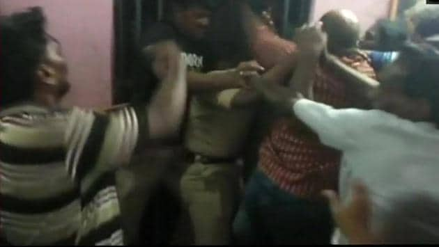 The mob beat up policemen in Andhra Pradesh's Nellore district.(ANI Photo)