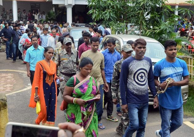 Police take away some of the convicts after they were sentenced life term by a court for lynching five women in a case of witch hunting at Mandar block in 2016, in Ranchi on Thursday, August 2, 2018.(PTI)