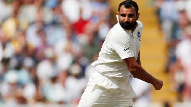 India's Mohammed Shami celebrates after taking the wicket of England's Dawid Malan.(Action Images via Reuters)