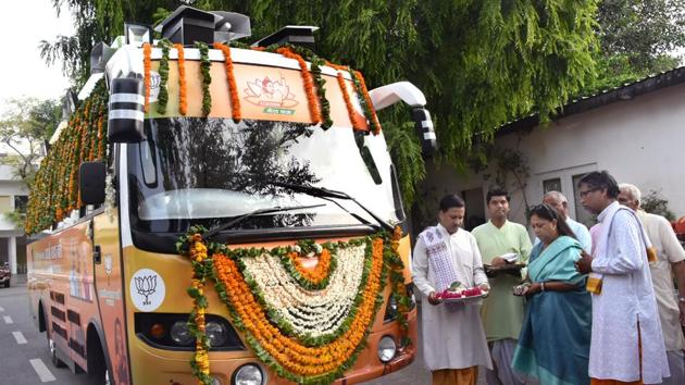 Chief minister Vasundhara Raje performs puja of the rath (bus) that will be used for 'Rajasthan Gaurav Yatra' at CM House on Friday.(Prabhakar Sharma/HT PHOTO)
