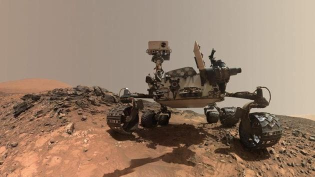 A low-angle self-portrait of NASA's Curiosity Mars rover vehicle at the site from which it reached down to drill into a rock target called 'Buckskin' on lower Mount Sharp.(AFP File Photo)