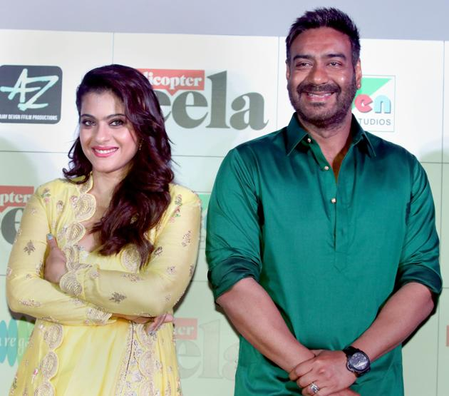 Kajol Devgn and Ajay Devgn pose for a picture as they celebrate the formers 43rd birthday during the trailer launch of their upcoming Hindi film Helicopter Eela.(PTI)