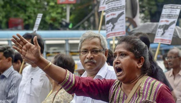 Communist Party of India (Marxist) activists take part in a protest rally against the Assam's National Register of Citizen draft, Kolkata, August 5, 2018(PTI)