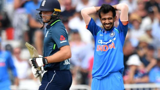 India's Yuzvendra Chahal (R) reacts during the One Day International (ODI) cricket match between England and India.(AFP)