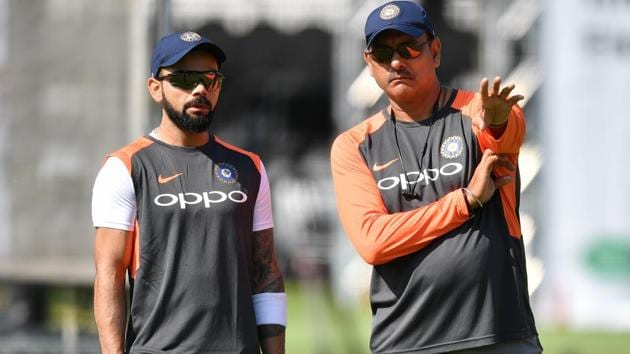 India's captain Virat Kohli (L) talks with India's head coach Ravi Shastri (R) during a practice session at Lord's Cricket Ground.(AFP)