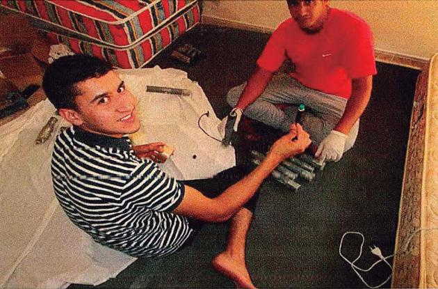 In this undated photo Abouyaaqouab Aalla and Hichamy, two of the terrorists that committed several attacks in Barcelona and Cambrils on August 17, 2017 killing 16 people, pose as they prepare hand-grenades at a house in Alcanar.(AFP photo)