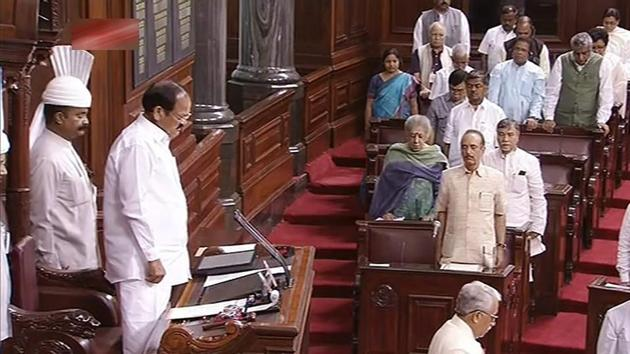 Rajya Sabha chairman M Venkaiah Naidu and the members observe a silence during an obituary reference in the House, in Parliament on July 18.(PTI Photo)