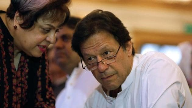 Imran Khan, chairman of the Pakistan Tehreek-e-Insaf (PTI), listens to his lawmaker Shireen Mazari during unveiling party's manifesto for the upcoming general election, in Islamabad, Pakistan July 9, 2018.(Reuters File Photo)