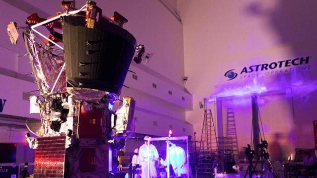 Engineers perform light bar testing on NASA's Parker Solar Probe at the Astrotech processing facility. (AFP File Photo)
