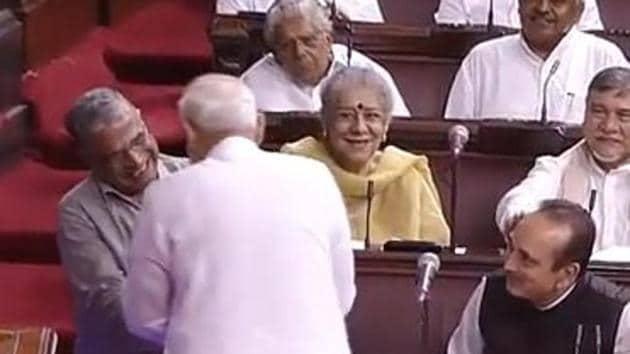 Prime Minister Narendra Modi congratulates NDA candidate Harivansh Narayan Singh who was elected as Rajya Sabha deputy chairman on Thursday.(ANI Photo/Twitter)