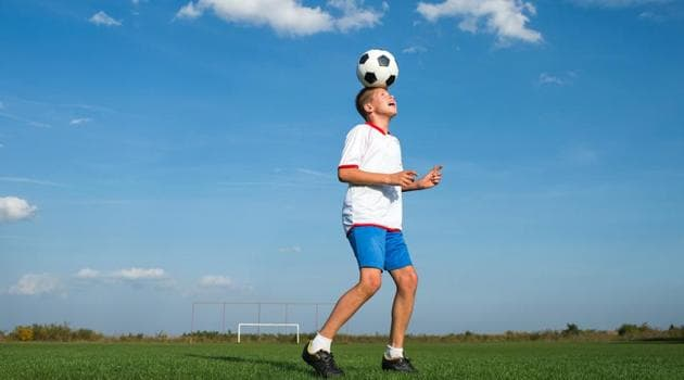 A brain specialist says that kids under the age of 12 to 14 should play a less contact form of soccer which we should develop for them. Kids between 12 and 18 can play but should not head the ball.(Shutterstock)
