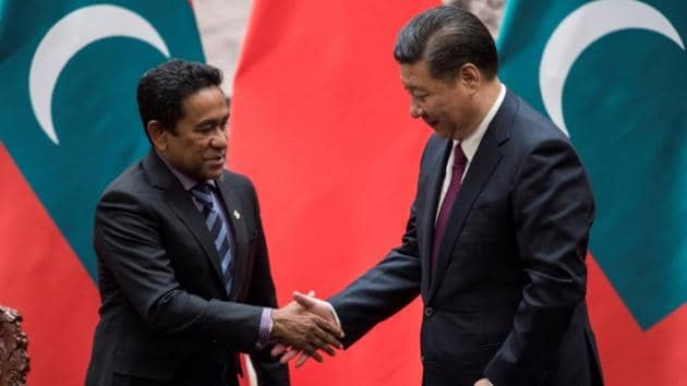 Maldives President Abdulla Yameen shakes the hand of China's President Xi Jinping after a signing meeting at the Great Hall of the People in Beijing.(Reuters File)
