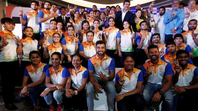 Members of the Indian contingent, participating in the 2018 Asian Games, pose for a picture during a send-off ceremony.(REUTERS)