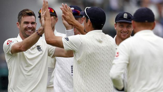 James Anderson (L) celebrates after taking the wicket of Murali Vijay during the second Test between India and England at Lord's.(AFP)