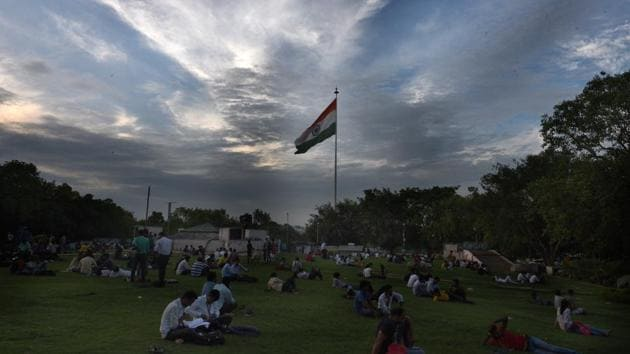 A view of cloudy weather in the evening at Palika Bazar Park, Connaught Place, New Delhi.(Sonu Mehta/HT PHOTO)