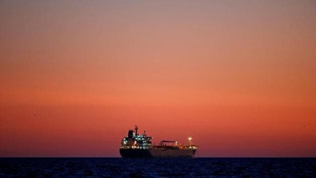 An oil tanker is seen at sunset anchored off the Fos-Lavera oil hub near Marseille, France.(REUTERS File Photo)