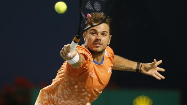 Stan Wawrinka (SUI) stretches to return a ball to Rafael Nadal in the Rogers Cup tennis tournament.(USA TODAY Sports)