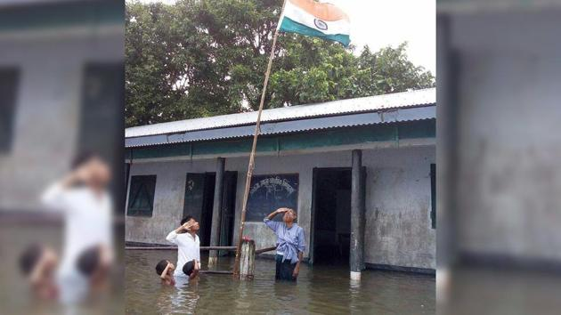 Tajen Sikdar, the head teacher of the primary school in Dhubri district, who had stood in the flood water with Haider Ali Khan and two others, told PTI on Wednesday that Haider's name was not in the draft NRC that was published on July 30, though those of his family members were there.(Photo: Joydev Roy)