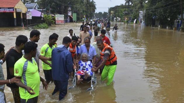 An elderly woman is evacuated towards safer area in Thrissur, Kerala.(AP Photo)