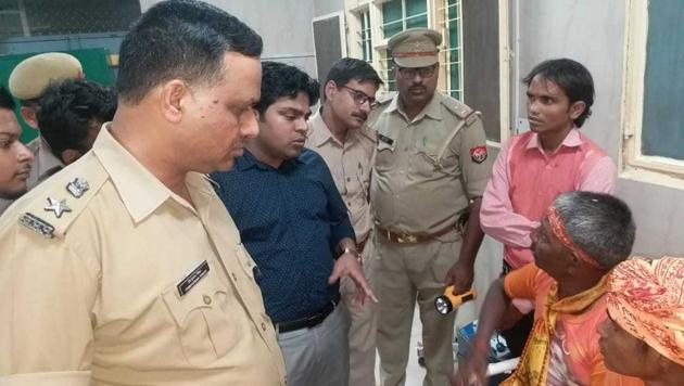 Police speak to victims at the hospital after more than 30 kanwariyas alleged they were attacked in Farrukhabad.