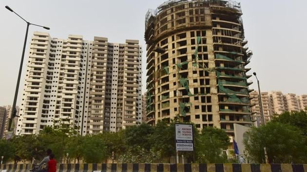 A view of under-construction Supertech building at sector 77, in Noida.(Virendra Singh Gosain/HT File Photo)