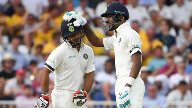 India's Rishabh Pant (L) is congratulated by India's Hardik Pandya (R) after hitting a six during the first day of the third Test cricket match between England and India at Trent Bridge in Nottingham, central England on August 18, 2018. (Photo by Paul ELLIS / AFP) / RESTRICTED TO EDITORIAL USE. NO ASSOCIATION WITH DIRECT COMPETITOR OF SPONSOR, PARTNER, OR SUPPLIER OF THE ECB(AFP)