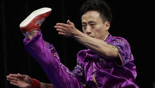 China's Peiyuan Sun perform during the Wushu men's Changquan games at the Asian Games in Jakarta.(AP)