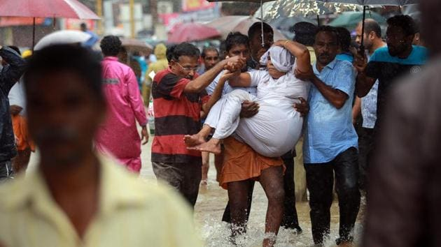 <p>People carry an elderly woman to safety in south Kerala&rsquo;s Pathanamthitta. Flood water from heavy rains over the past 10 days have left Kerala in a...