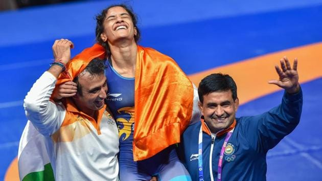 Jakarta: India's Vinesh Phogat celebrates after winning the Gold medal in women's freestyle 50 kg wrestling at the Asian Games 2018, in Jakarta on Monday, August 20, 2018. Phogat made the history after she became the first Indian woman to win a gold at Asian Games. She beat Japan's Irie Yukie 6-2 in the finals.(PTI)