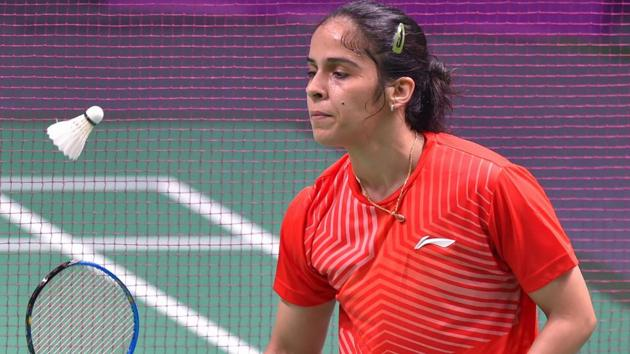 Saina Nehwal in action against Nozomi Okuhara at Women's Team quarterfinals event in Asian Games 2018.(PTI)