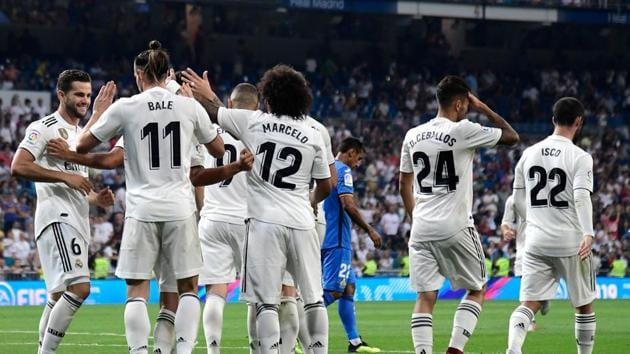 Real Madrid's Welsh forward Gareth Bale (2ndL) celebrates with teammates after scoring a goal during the Spanish League football match between Real Madrid and Getafe.(AFP)