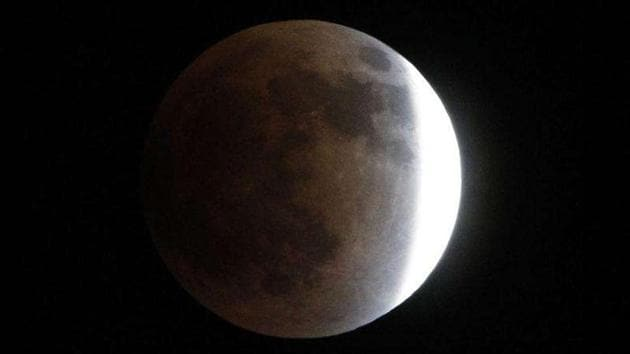 The Earth casts its shadow across the moon's surface during the lunar eclipse in Tokyo.(AP Photo)