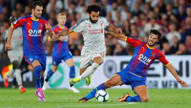 Liverpool's Mohamed Salah in action with Crystal Palace's James Tomkins and Luka Milivojevic.(REUTERS)