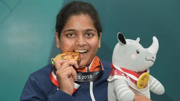 Gold medalist shooter Rahi Sarnobat poses for photograph after the presentation ceremony of women's 25m pistol event during the 18th Asian Games.(PTI)