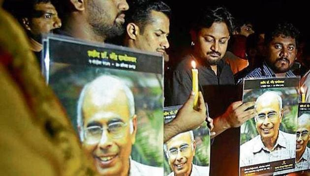 Supporters hold a rally on the eve of fifth death anniversary of Narendra Dabholkar in Pune on Sunday.(HT Photo)