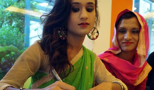 A transgender who has been working as a dancer and a make-up artist in Uttar Pradesh signs a letter that will be sent to the Prime Minister, along with a rakhi.(Gokul V.Shime/HT)