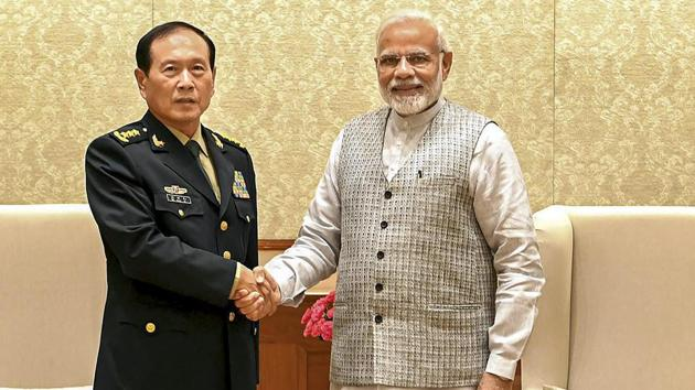 Prime Minister Narendra Modi shakes hands with China's defence minister, General Wei Fenghe, during a meeting in New Delhi on Tuesday, August 21, 2018.(PTI)