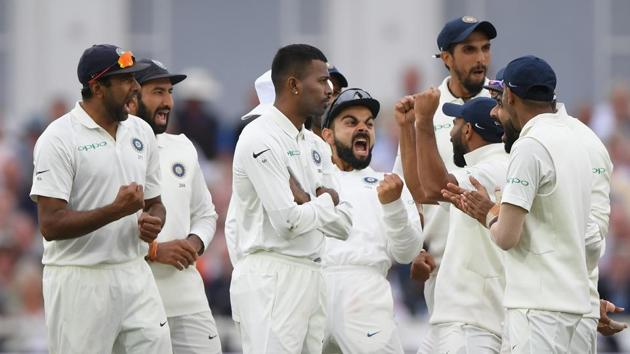 India captain Virat Kohli (c) and team mates celebrate after Joe Root is given out after a review during day two of the 3rd Specsavers Test Match between England and India at Trent Bridge on August 19, 2018 in Nottingham, England.(Getty Images)