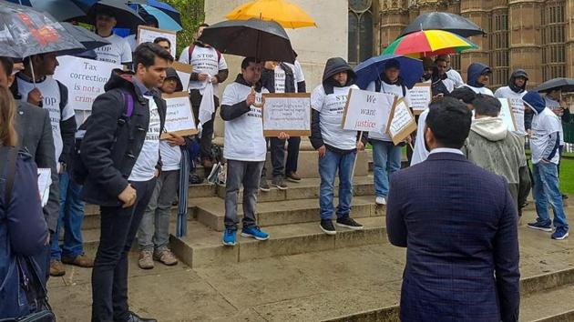 File photo of Indian professionals protesting against visa rules, outside the UK Parliament in London.(PTI)